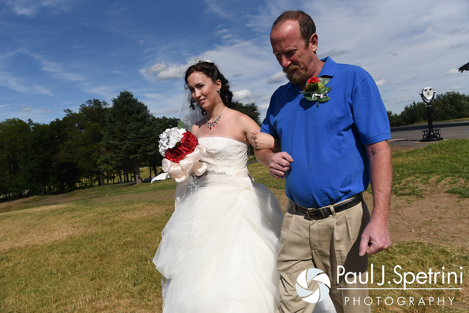 Amanda is walked down the aisle by her father during her summer wedding at the Quabbin Reservoir Observation Tower in Belchertown, Massachusetts on July 2nd, 2016.