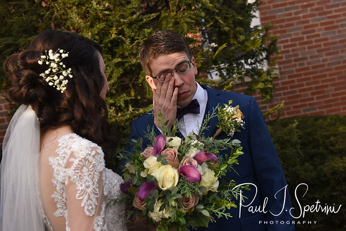 Mack sheds a tear with Stacey following their December 2018 wedding ceremony at St. Teresa's Church in Attleboro, Massachusetts.