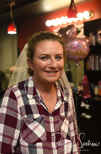 Allie smiles during her hair and makeup appointment at Per Case Salon in Smithfield, Rhode Island prior to her October 2018 wedding ceremony at South Ferry Church in Narragansett, Rhode Island.