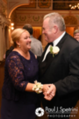 The parents of the bride dance during Allison and Len's September 2017 wedding reception at the Roger Williams Park Casino in Providence, Rhode Island.