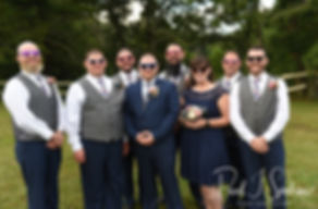 Adam poses for a photo with his groomsmen following his September 2018 wedding ceremony at Stepping Stone Ranch in West Greenwich, Rhode Island.