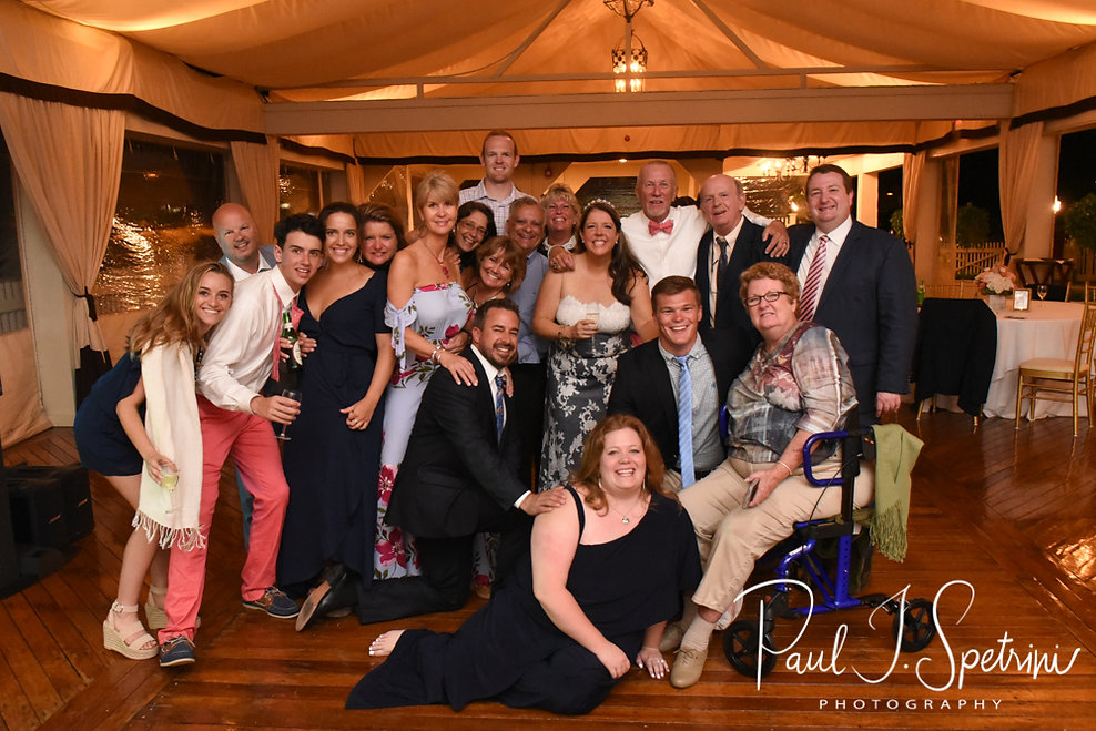 Mike and Kate pose for a photo with guests during their May 2018 wedding reception at Regatta Place in Newport, Rhode Island.
