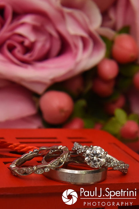 A look at the wedding rings on display during Cynthia and Ao's August 2017 wedding reception at Lake Pearl in Wrentham, Massachusetts.