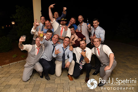 Eric poses for a photo with his friends during his May 2016 wedding at Hillside Country Club in Rehoboth, Massachusetts.