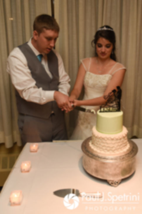 Neil and Gianna cut their wedding cake during their July 2017 wedding reception at Quidnessett Country Club in North Kingstown, Rhode Island.