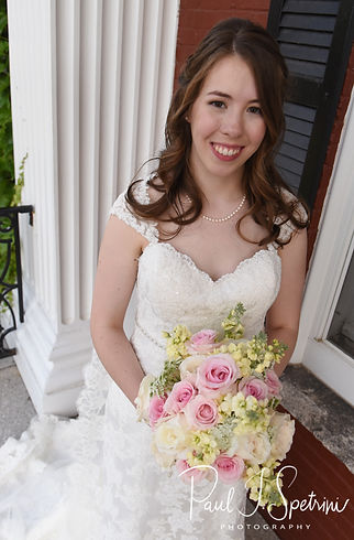 Sarah poses for a formal photo following her June 2018 wedding ceremony at the College of the Holy Cross in Worcester, Massachusetts.