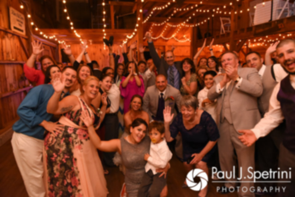 Kevin and Jen pose for a large group photo during their September 2017 wedding reception at Allen Hill Farm in Brooklyn, Connecticut.
