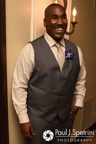 "Warren laughs moments before he and Kemi share a ""First touch"" prior to their August 2016 wedding reception at the Villa at Riddler Country Club in East Bridgewater, Massachusetts."