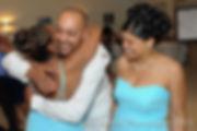Joe Andrade gets a hug at the end of his wedding.