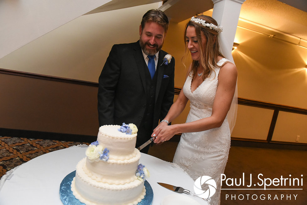 Kevin and Joanna cut the cake during their October 2017 wedding reception at Cranston Country Club in Cranston, Rhode Island.