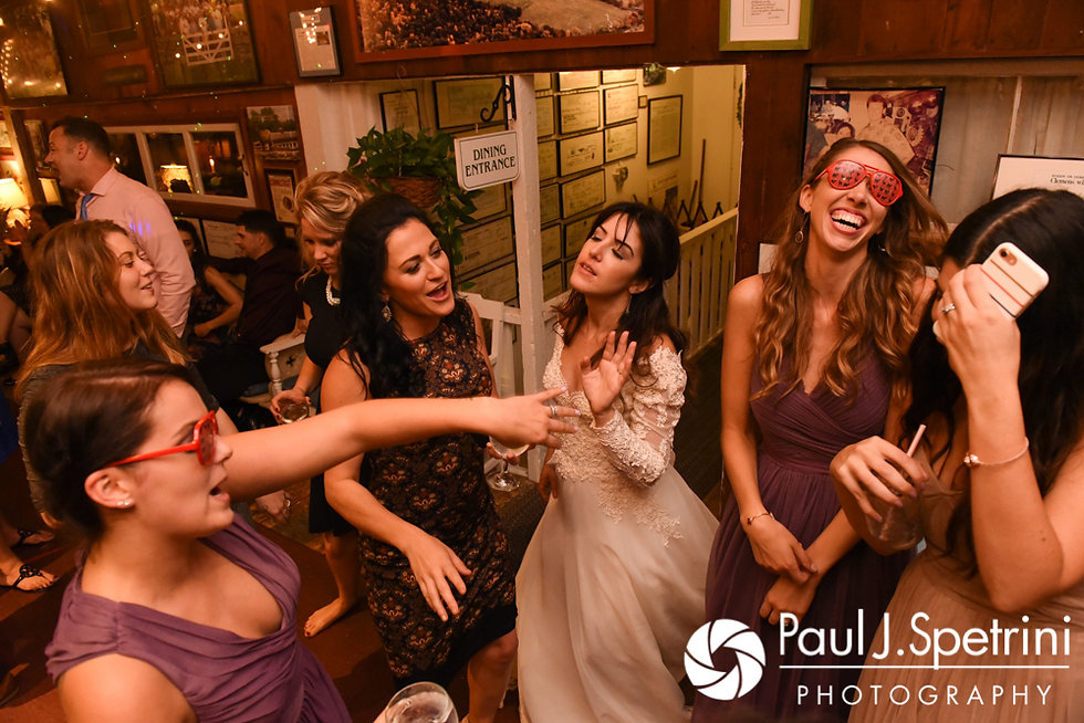 Samantha dances with guests during her and Dale's October 2017 wedding reception at the Golden Lamb Buttery in Brooklyn, Connecticut.