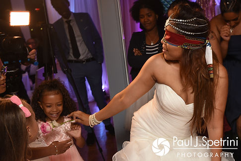 Lucelene hands out roses while blindfolded during her June 2017 wedding reception at Al's Waterfront Restaurant in East Providence, Rhode Island.