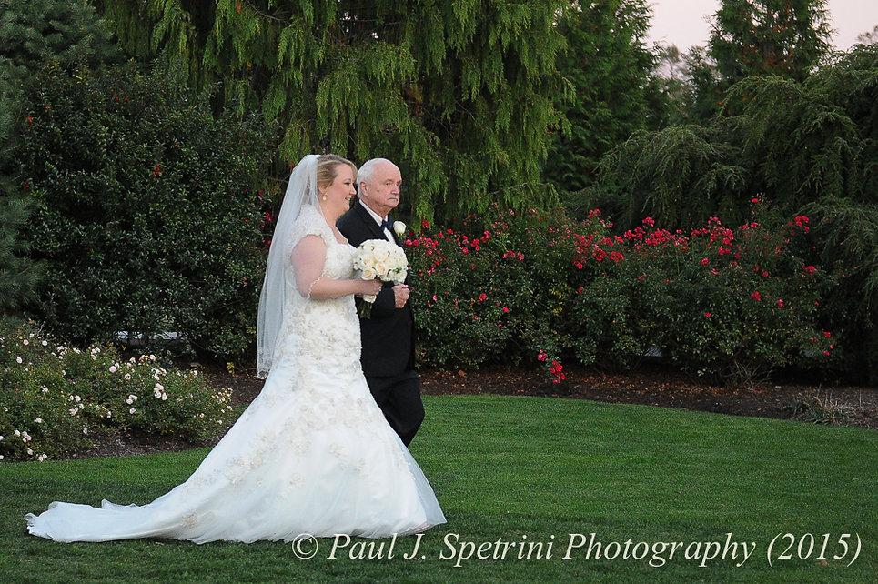 Kerry and her father walk into her wedding ceremony at Quidnessett Country Club in North Kingstown, Rhode Island on October 23rd, 2015.