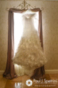 Michelle's dress hangs in a window prior to her May 2016 wedding at Hillside Country Club in Rehoboth, Massachusetts.