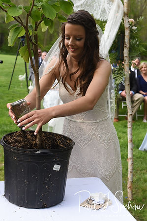 Ryan puts dirt in a pot during her May 2018 wedding ceremony at Bittersweet Farm in Westport, Massachusetts.