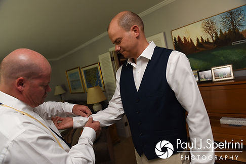 Kelly has his buttons fixed prior to his August 2017 wedding ceremony in Warwick, Rhode Island.