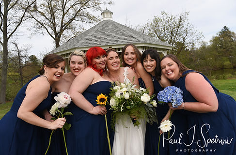Ali poses for a photo with her bridesmaids prior to her May 2018 wedding ceremony at the Roger Williams Park Botanical Center in Providence, Rhode Island.