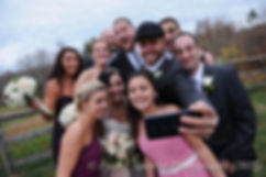 Mike and Emma's wedding party pose for a photo prior to their November 2015 wedding at the Publick House in Sturbridge, Massachusetts.