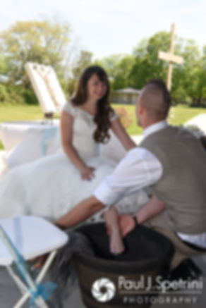 Ian washes Krystal's feet during their May 2016 wedding at Colt State Park in Bristol, Rhode Island.
