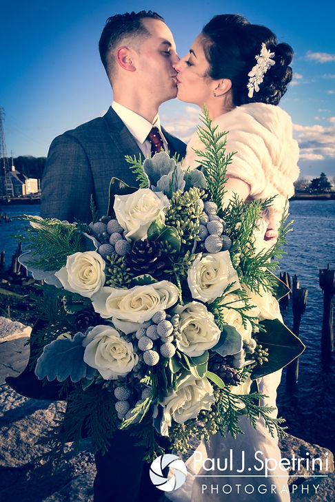 Gina and David kiss during a formal photo prior to their December 2016 wedding ceremony at the Waterman Grille in Providence, Rhode Island.