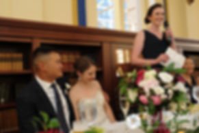 Dan and Simonne listen to the maid of honor's toast during their June 2016 wedding in Providence, Rhode Island.