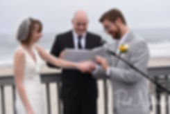 Justin puts a ring on Amber's hand during their June 2018 wedding ceremony at North Beach Clubhouse in Narragansett, Rhode Island.