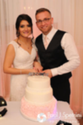 Maria and Sebastian cut the cake at their March 2016 wedding reception at Falores Restaurant in Pawtucket, Rhode Island.