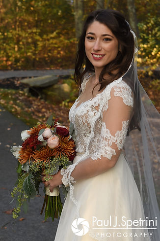 Jessica smiles for a formal photo prior to her October 2017 wedding reception at Crystal Lake Golf Club in Mapleville, Rhode Island.