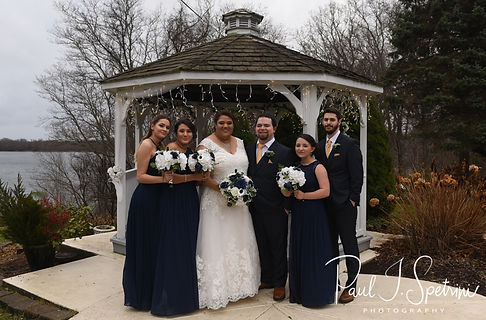 Gunnar and Aileen pose for a formal photo with members of their wedding party following their December 2018 wedding ceremony at McGoverns on the Water in Fall River, Massachusetts.