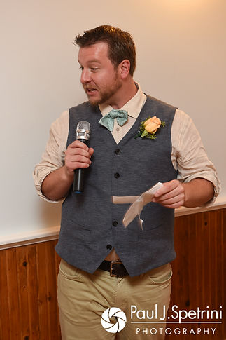 The best man gives a speech during Arielle and Gary's September 2017 wedding reception at North Beach Club House in Narragansett, Rhode Island.