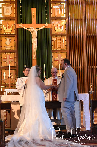 Sarah and Anthony receive a marital blessing during their October 2018 wedding ceremony at St. Augustine Catholic Church in Providence, Rhode island.