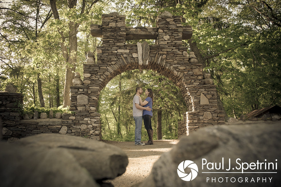 Jennifer and Kevin pose for a photo near a set of stones during their May 2017 engagement session at Gillette Castle State Park in East Haddam, Connecticut.