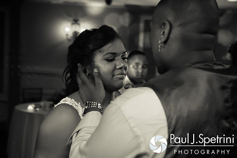 Kemi and Warren share a moment during their August 2016 wedding reception at the Villa at Riddler Country Club in East Bridgewater, Massachusetts.