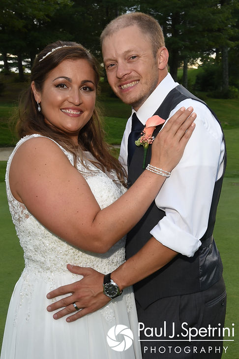 Toni and Scott smile for a photo following their August 2017 wedding ceremony at Crystal Lake Golf Club in Mapleville, Rhode Island.