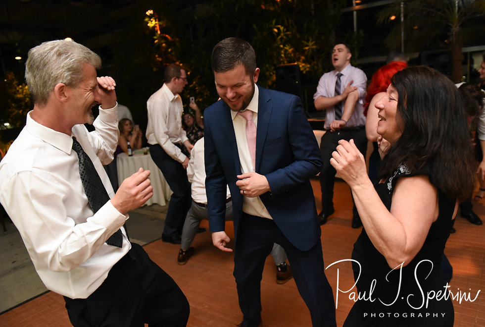 Gary and his parents dance during his May 2018 wedding reception at the Roger Williams Park Botanical Center in Providence, Rhode Island.