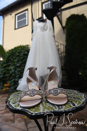 A look at Katie's wedding dress and shoes prior to Katie & Steve's October 2018 wedding ceremony at The Villa at Ridder Country Club in East Bridgewater, Massachusetts.