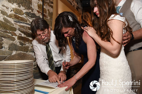 Krystal's mother sheds a tear while signing the marriage license for her daughter and Ian during the couple's May 2016 wedding reception at DeWolf Tavern in Bristol, Rhode Island.