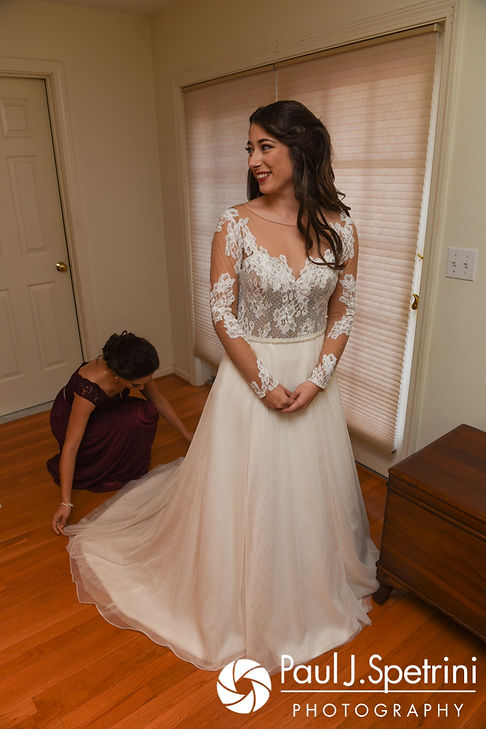 Jessica has her dress fluffed prior to her October 2017 wedding ceremony at the Assumption of the Blessed Virgin Mary Church in Providence, Rhode Island.