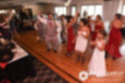 Guests dance during Heather and John's July 2016 wedding reception at Crystal Lake Golf Club in Burrillville, Rhode Island.