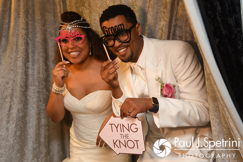 Lucelene and Luis pose for a photo booth photo during their June 2017 wedding reception at Al's Waterfront Restaurant in East Providence, Rhode Island.