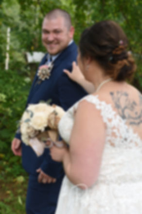 Adam turns to see Ashley during their first look prior to their September 2018 wedding ceremony at Stepping Stone Ranch in West Greenwich, Rhode Island.