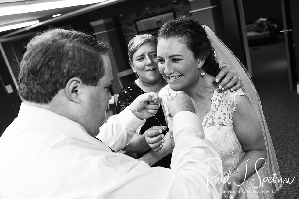 Allie has help with her necklace prior to her October 2018 wedding ceremony at South Ferry Church in Narragansett, Rhode Island.