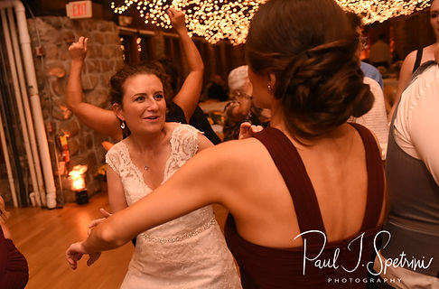 Allie dances with a guest during her October 2018 wedding reception at The Towers in Narragansett, Rhode Island.