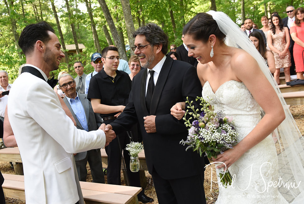 Kendra's dad gives her away during her May 2018 wedding ceremony at Crystal Lake Golf Club in Mapleville, Rhode Island.