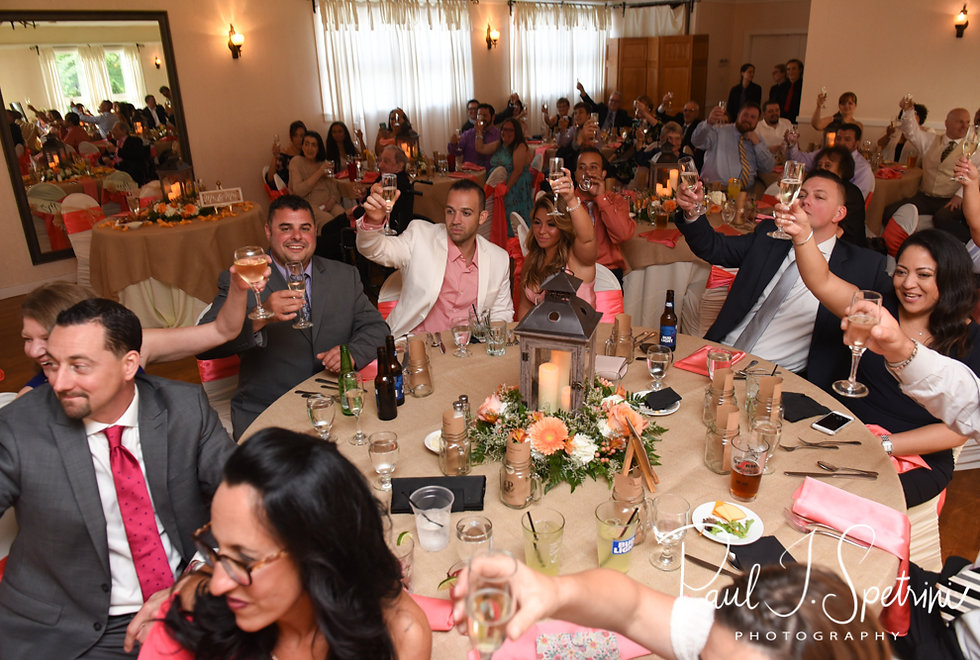 Guests toast the bride and groom during Jacob & Stephanie's June 2018 wedding reception at Foster Country Club in Foster, Rhode Island.