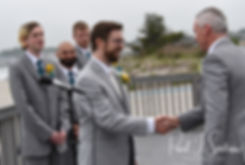 Justin shakes Amber's father's hand during his June 2018 wedding ceremony at North Beach Clubhouse in Narragansett, Rhode Island.