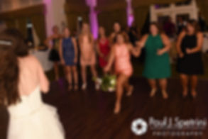 Alyssa throws her bouquet during her August 2016 wedding reception at LeBaron Hills Country Club in Lakeville, Massachusetts.