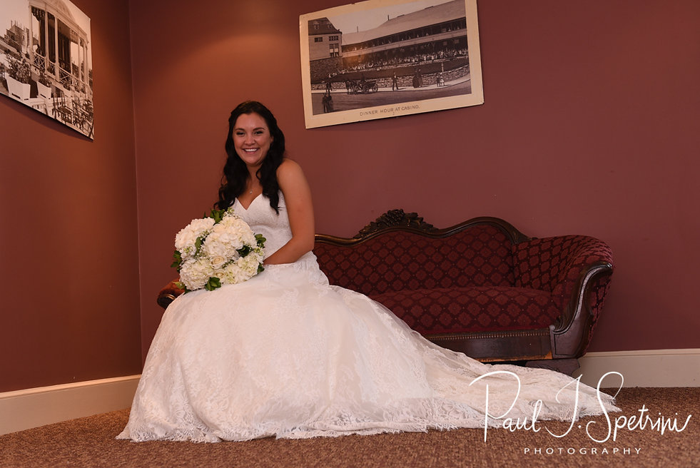 Nicole smiles for a photo prior to her September 2018 wedding ceremony at The Towers in Narragansett, Rhode Island.