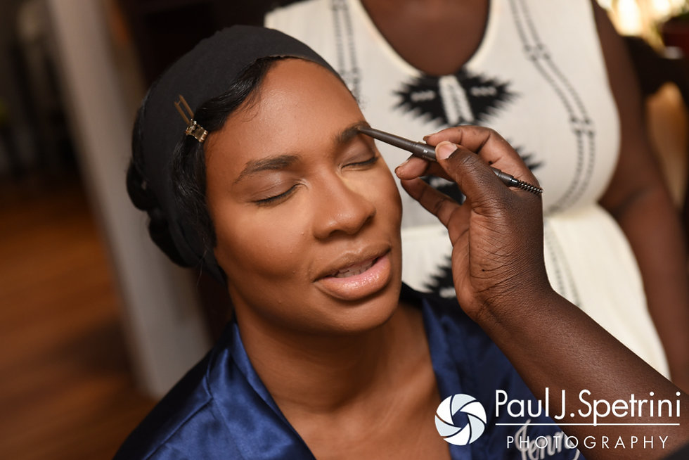 Jennifer has her makeup applied prior to her September 2016 wedding at the Roger Williams Park Temple of Music in Providence, Rhode Island.