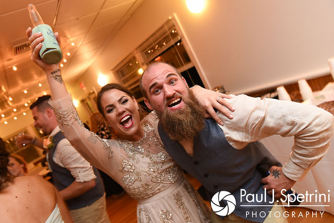 Arielle and Gary smile for a photo during their September 2017 wedding reception at North Beach Club House in Narragansett, Rhode Island.